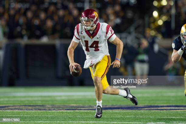 Trojans quarterback Sam Darnold scrambles away from pressure during the college football game between the Notre Dame Fighting Irish and USC Trojans...