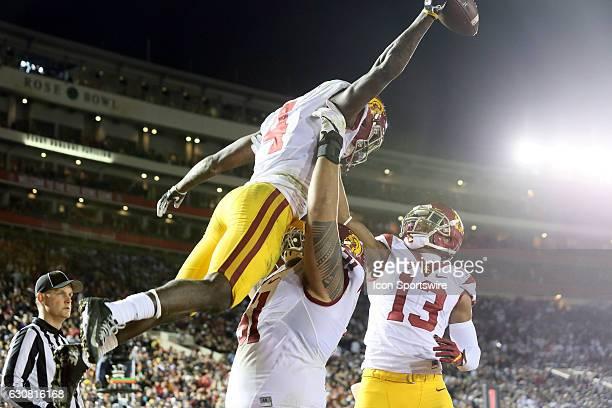 Trojans TB Ronald Jones II celebrates with USC Trojans OG Damien Mama and USC Trojans WR De'Quan Hampton after scoring on a 3yard touchdown run...