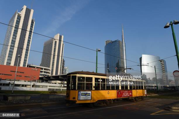 A trolley car goes past in Milan's Garibaldi neighbourhood on February 20 2017 The Lombard capital has become the nerve centre of the country teeming...