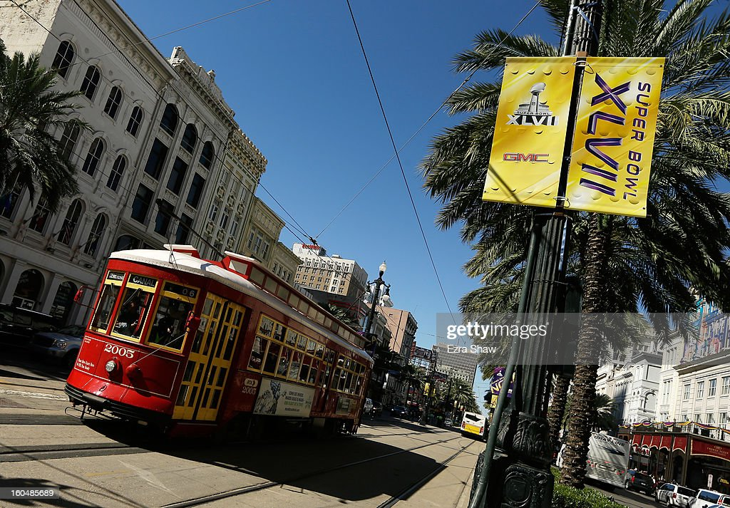 A trolley car passes signage for Super Bowl XLVII on February 1, 2013 in New Orleans, Louisiana.