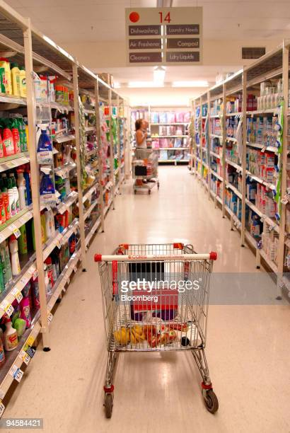 A trolley stands in an aisle with customers shopping at a Coles supermarket situated in the centre of Melbourne's Central business district on...