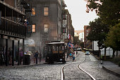 A trolley stops to pick up passengers on River Street in Savannah Georgia US on Saturday Aug 15 2015 Savannah the oldest city and thirdlargest...