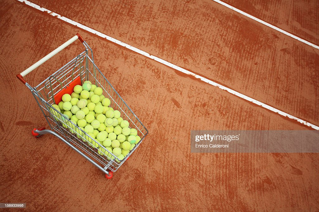 Trolley With Tennis Balls In Tennis Court : Photo