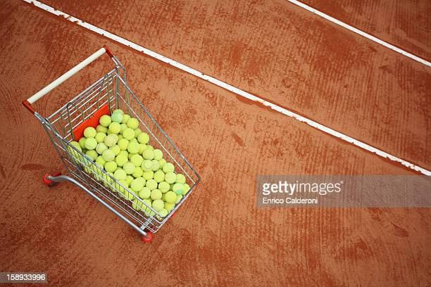 Trolley With Tennis Balls In Tennis Court