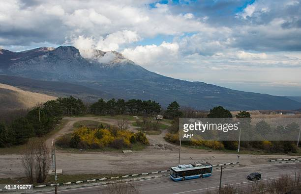 A trolleybus rides from the peninsula's main city Simferopol to the Black Sea coastal resort of Yalta on March 28 2014 Almost every day for the past...