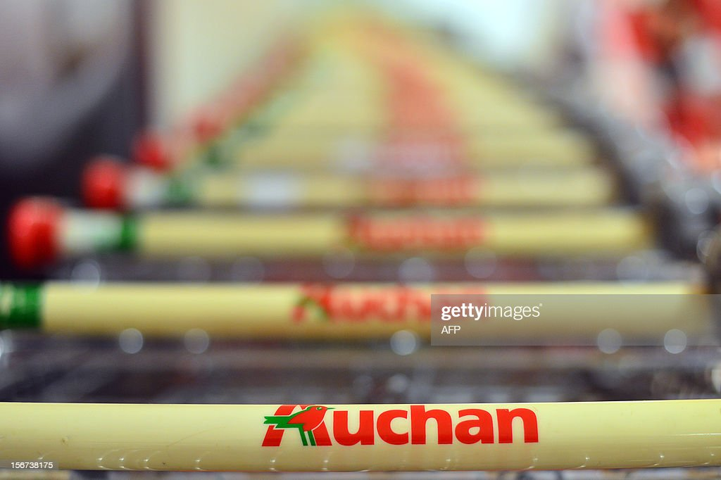 Trolleys are parked outside a Auchan supermarket in Rome on November 19, 2012 in Rome.