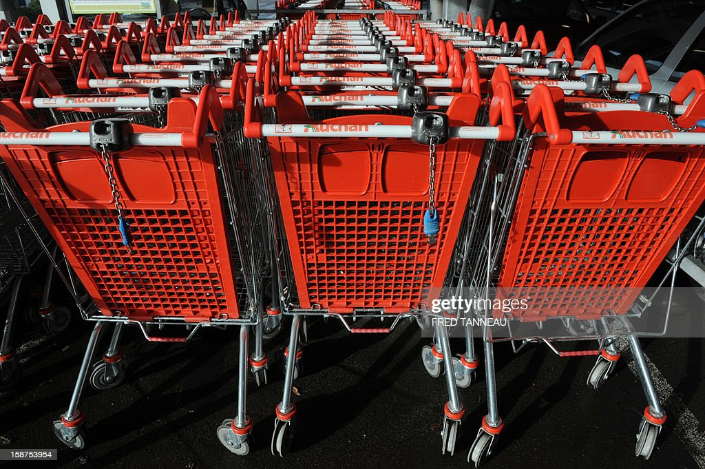 Trolleys are seen outside a supermarket Auchan on December 27, 2012 in Saint-Sebastien-sur-Loire, western France.
