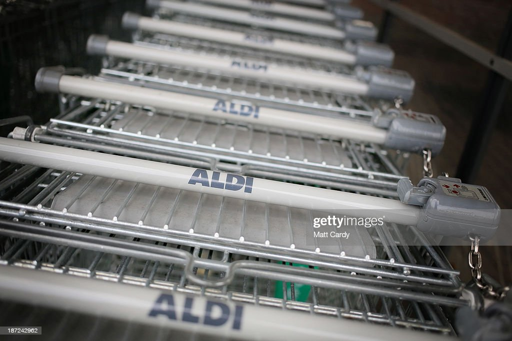 Trolleys belonging to a branch of the budget supermarket Aldi are seen on November 7, 2013 in Bristol, England. As the German chain opens its 500th store in the affluent Bury St Edmunds, some retail experts are claiming that the low-cost supermarket is trying to attract more affluent shoppers, in particular by offering large discounts on luxury items.