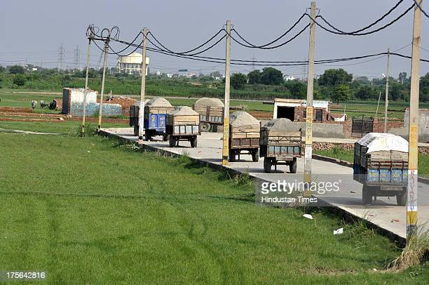 Trolleys filled with sand beelined at Badarpur village near Loni on August 3 2013 in Ghaziabad India After Gautam Budh Nagar Ghaziabad is fast...