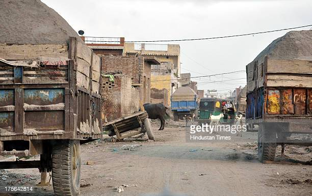 Trolleys filled with sand parked at Badarpur village near Loni on August 3 2013 in Ghaziabad India After Gautam Budh Nagar Ghaziabad is fast emerging...