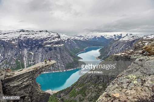 Trolltunga, Troll's Tongue, Ringedalsvatn reservoir below, Folgefonn Glacier at the back, near Odda, Hordaland province, Vestland or Western Norway, Norway
