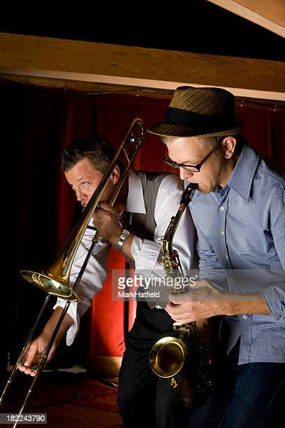 Trombone and Saxophone Player At Bar