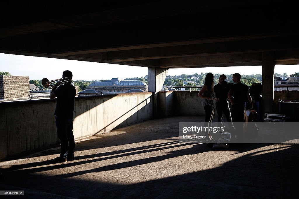 A trombone player from the MultiStory Orchestra practices before a performance of Jean Sibelius' 5th Symphony at the Peckham Rye Car Park on June 21...