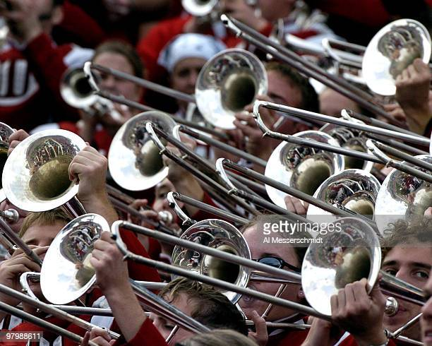 Trombone section of the Wisconsin band pumps out a tune at the 2005 Outback Bowl January 1 2005 at Raymond James Stadium Tampa Florida Georgia...