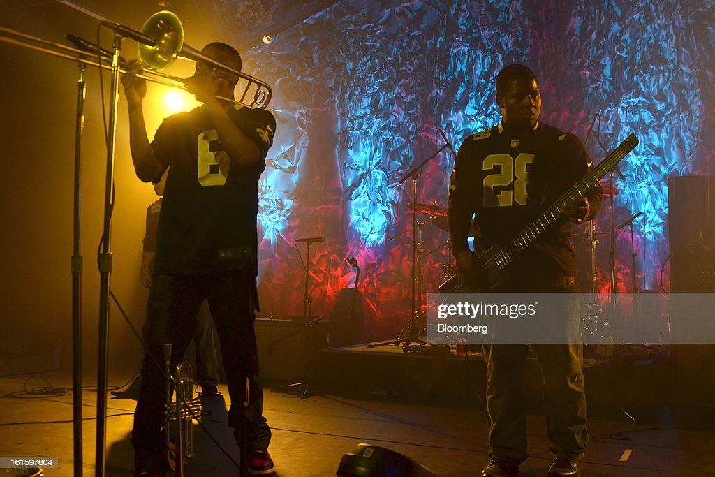 Trombone Shorty, left, and a bandmate perform at a party hosted by Tom and Gayle Benson, owners of the New Orleans Saints, in New Orleans, Louisiana, U.S., on Thursday, Jan. 31, 2013. The party in City Park kicked off a weekend of festivities before Super Bowl XLVII. Photographer: Amanda Gordon/Bloomberg via Getty Images