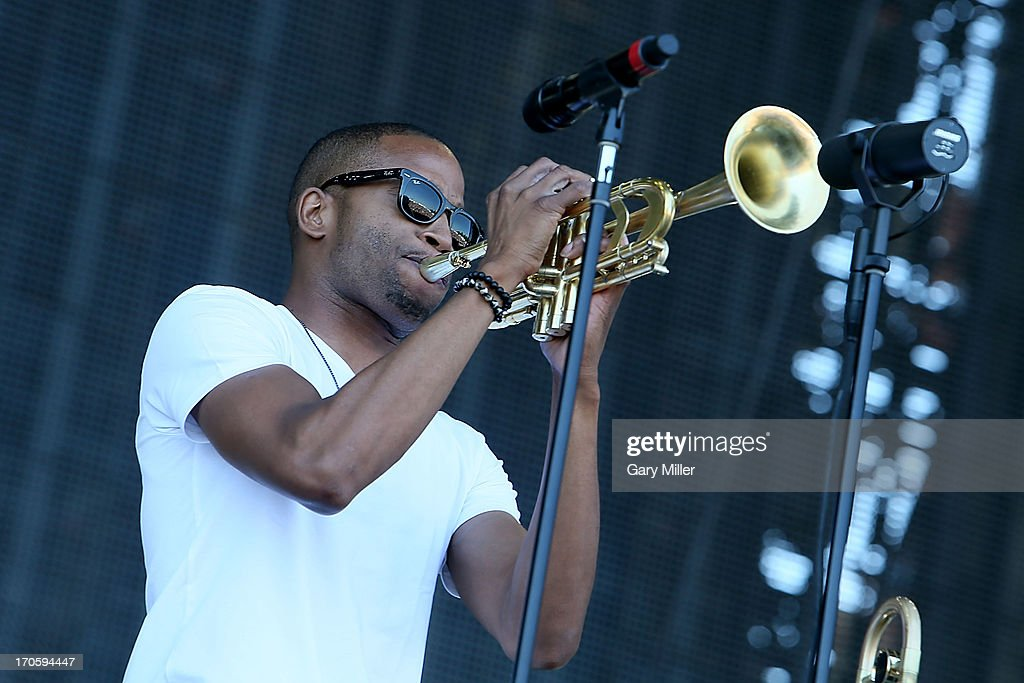 Trombone Shorty performs during the 2013 Bonnaroo Music & Arts Festival on June 14, 2013 in Manchester, Tennessee.