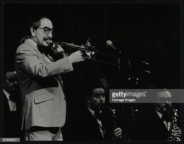 Trombonist Don Lusher playing with the Ted Heath Orchestra Artist Denis Williams