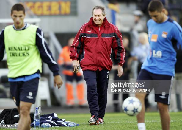 French Lyon coach Gerard Houllier watches his players during a training session 27 september 2005 at the Lerkendal stadium in Trondheim on the eve of...