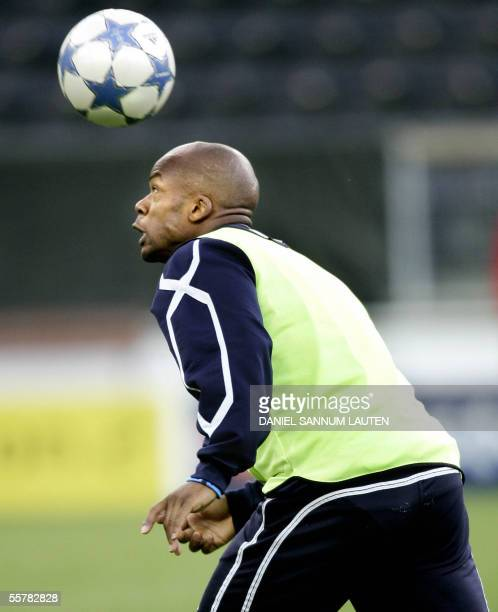 Lyon's Sylvain Wiltord plays with the ball during a training session 27 September 2005 at the Lerkendal stadium in Trondheim on the eve of the second...