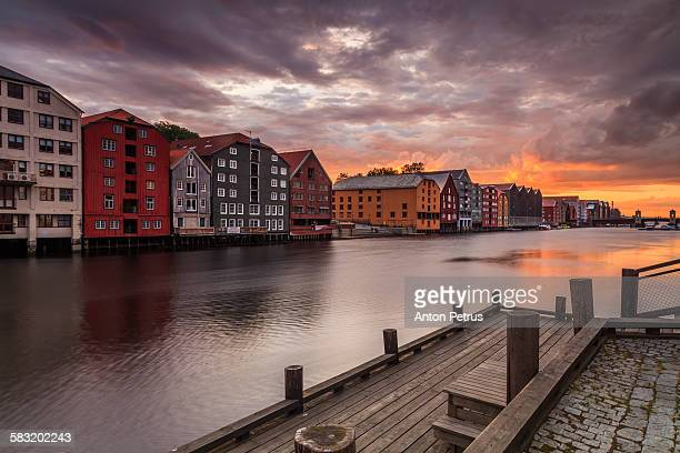 Trondheim on sunset sky background.