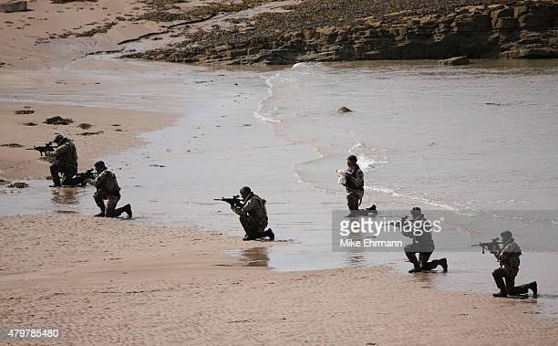 A troop of Royal Marines from the 43 Commando land on a beach via the Firth of Forth to deliver the Scottish Open trophy for 'safe keeping' prior to...