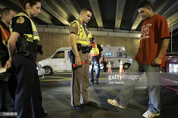 Trooper David Casillas from the Florida Highway Patrol conducts a field sobriety test at a DUI checkpoint December 15 2006 in Miami Florida The city...