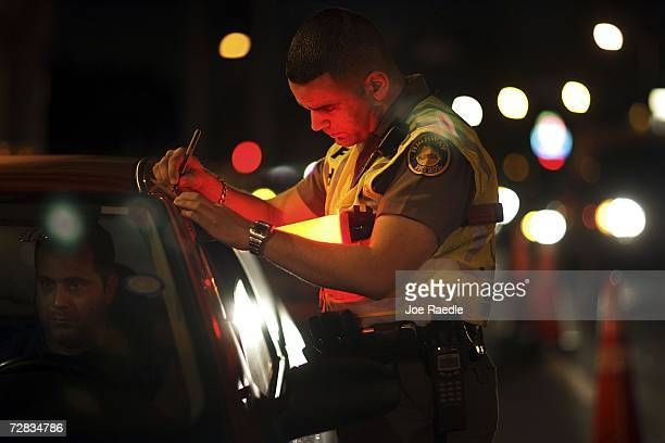 Trooper David Casillas from the Florida Highway Patrol talks to a driver at a DUI checkpoint December 15 2006 in Miami Florida The city of Miami with...