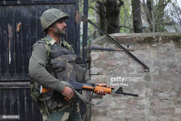 BSF trooper guarding outside the Government Higher Secondary School in Srinagar Indian Controlled Kashmir on Wednesday April 05 2017 The additional...