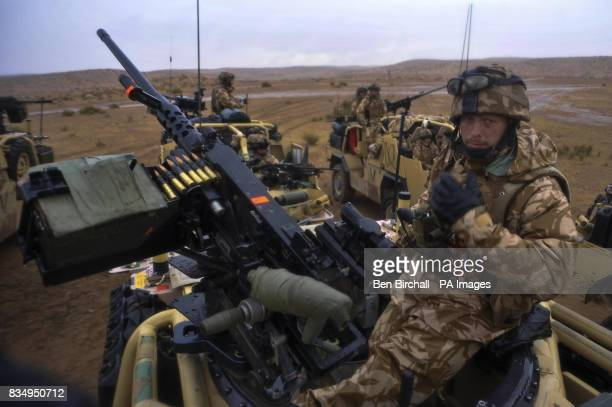 Trooper Liam Davies from Wrexham mans a 50 calibre machine gun on top of a Jackal with the 1st The Queens Dragoon Guards after spending the night in...