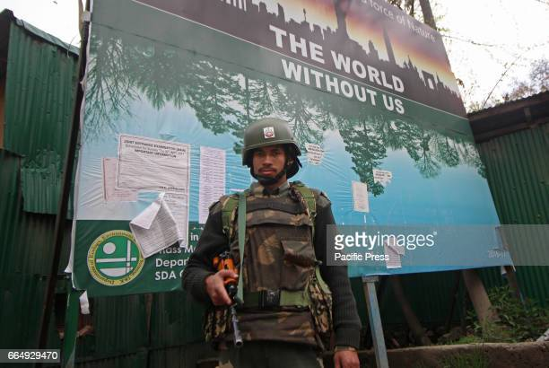 BSF trooper standing alert inside the premises of Government Higher Secondary School in Srinagar Indian Controlled Kashmir on Wednesday April 05 2017...
