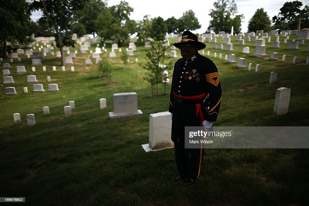 Trooper William H. Hunter of the 9th and 10th DC chapter of the Buffalo Soldiers participates in an event at the gravesite of Buffalo Soldier Col. Charles Young, at Arlington Cemetery, June 5, 2013 in Arlington, Virginia. The event was hosted by the National Coalition of Black Veterans and the Omega Psi Phi Fraternity to celebrate the 90th anniversary of 'Buffalo Soldier' and military leader Col. Charles Young's internment in Arlington Cemetery.