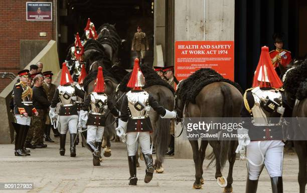 Troopers from the Blues and Royals part of the Household Cavalry Mounted Regiment walk their horses back to stables at the Hyde Park Barracks...