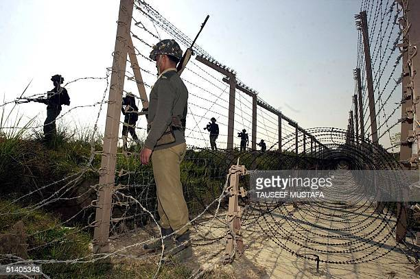 Troopers of the Border Security Force patrol near the Line of Control that divides Indian and Pakistani Kashmir at Ramgarh sector 27 December 2001...