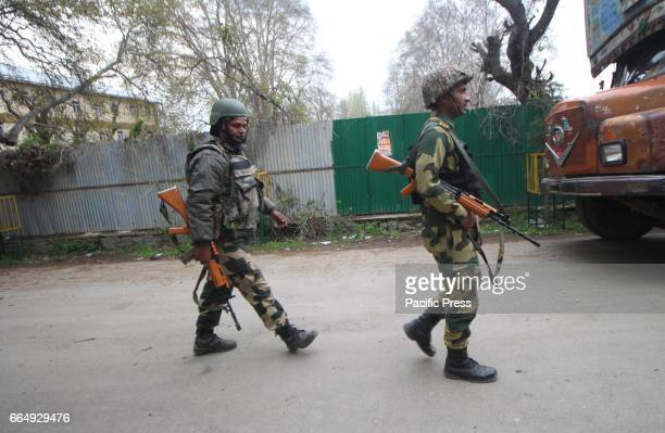 BSF troopers walking towards Government Higher Secondary School in Srinagar Indian Controlled Kashmir on Wednesday April 05 2017 The additional force...