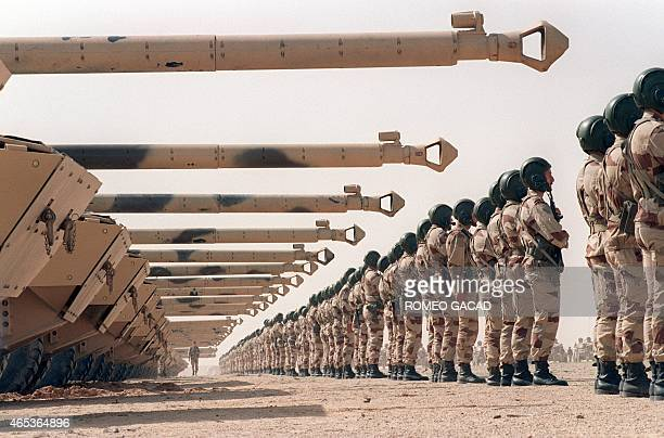 Troops and AMX10RC tanks of the French lightarmored Spahi regiment stand in formation during a departure ceremony 12 March 1991 in King Khaled...