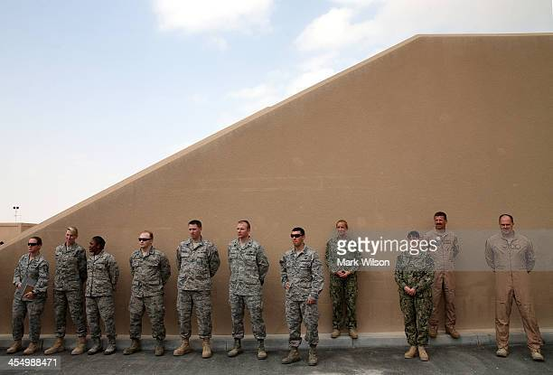 Troops are gathered to hear US Secretary of Defense Chuck Hagel speak on December 10 2013 at Al Udeid Airbase west of Doha Qatar Secretary Hagel...