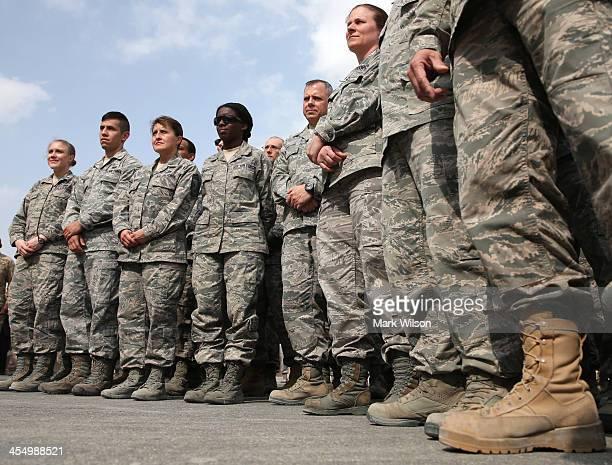 Troops are gathered to hear US Secretary of Defense Chuck Hagel speak on December 10 2013 at Al Udeid Airbase west of Doha Qatar Secretary Hagel...