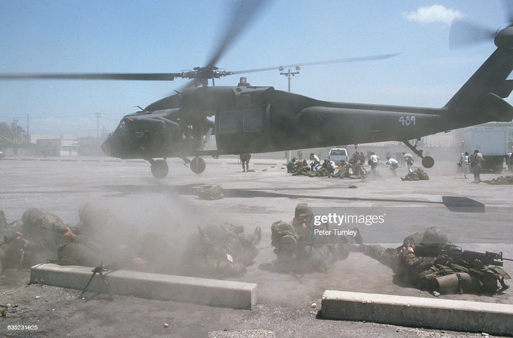 US troops arrive in PortauPrince Haiti to insure a peaceful transition of government from General Raoul Cedras to JeanBertrand Aristide