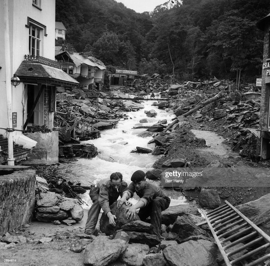 Troops clearing rocks in the devastated village of Lynmouth, Devon, following a flood which destroyed many of the houses and left several villagers dead. Original Publication: Picture Post - 6012 - Lynmouth - pub. 1952