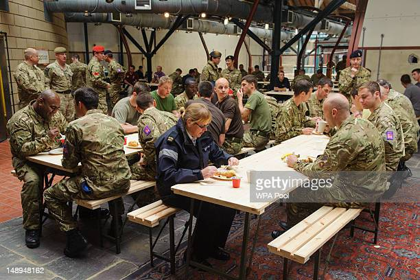 Troops eat in the canteen at the temporary Olympic Army barracks at Tobacco Dock a former shopping centre on July 20 2012 in London England An...
