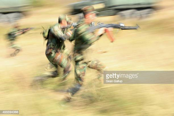 Troops from Azerbaijan charge forward in an attack on US soldiers on the third day of the 'Rapid Trident' bilateral military exercises between the...