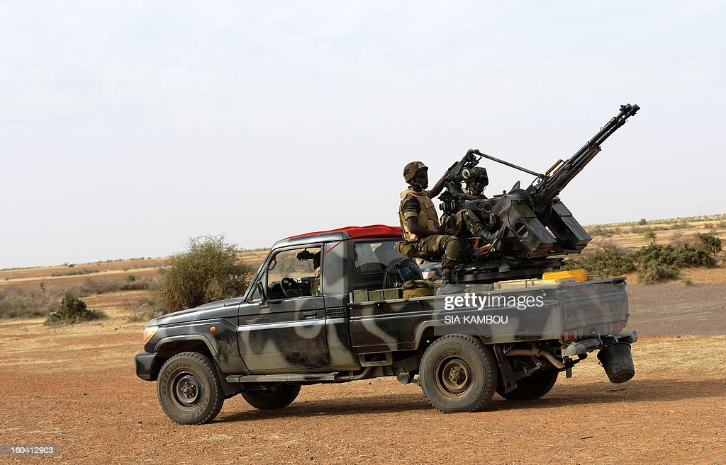 Troops from Niger on January 29, 2013 enter the town of Ansongo which along with Gao was recaptured by French-led soldiers over the weekend in a lightning offensive against radicals holding Mali's north..