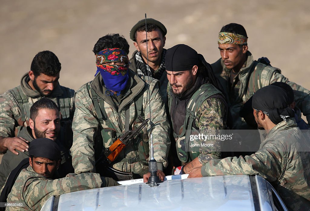 Troops from the Syrian Democratic Forces head towards the frontline on November 9, 2015 near the ISIL-held town of Hole in the autonomous region of Rojava, Syria. The forces, a coalition of Kurdish and Arab units, are attacking ISIL extremists in the area near the Iraqi border. The predominantly Kurdish region of Rojava in northern Syria has become a bulwark against the Islamic State. Their mostly Kurdish armed forces, with the aid of U.S. airstrikes and weapons, have been battling ISIL, who had earlier captured much of the region from the Syrian regime.
