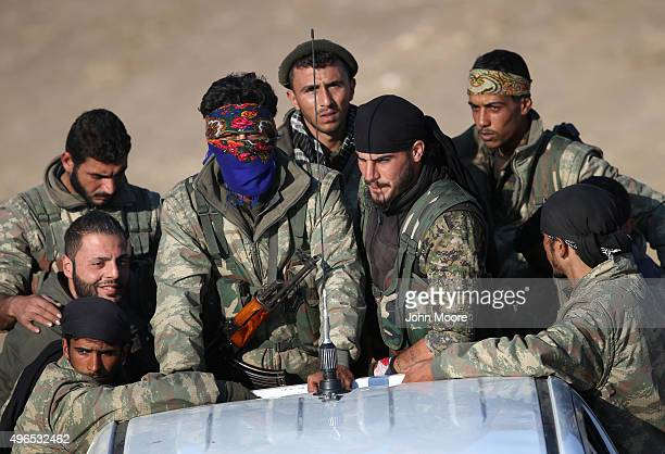 Troops from the Syrian Democratic Forces head towards the frontline on November 9 2015 near the ISILheld town of Hole in the autonomous region of...