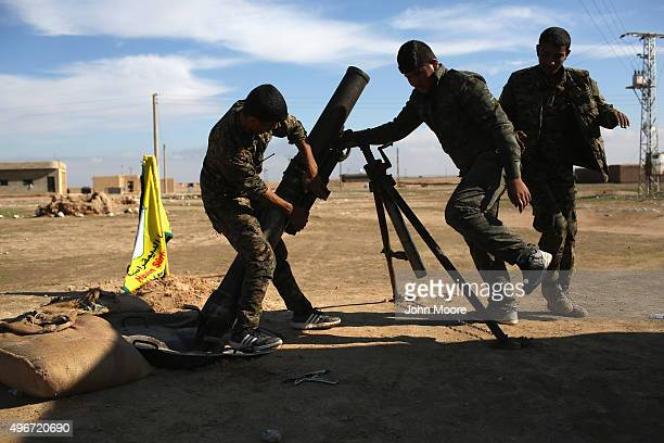 Troops from the Syrian Democratic Forces prepare to fire mortars on ISIL positions on the frontline on November 11 2015 near Hasaka in the autonomous...