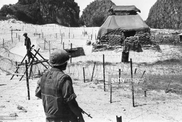 US troops guarding defences near Hui Kinson Vietnam