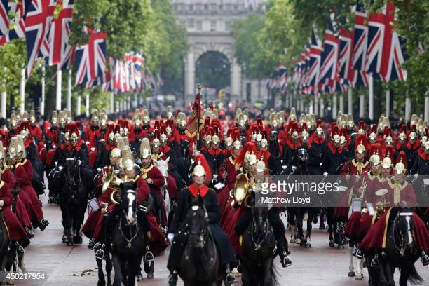 Troops in ceremonial dress march down The Mall in front of Buckingham Palace as they take part in The Colonel's Review on June 7 2014 in London...