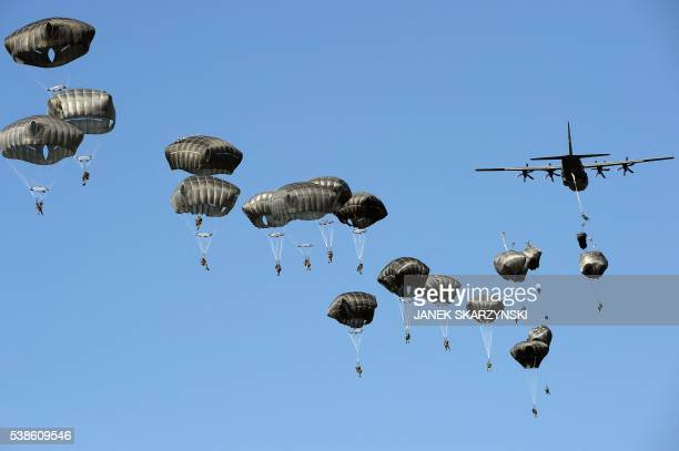 US troops land with parachutes at the military compound near Torun central Poland on June 7 as part of the NATO Anaconda16 military exercise Anaconda...
