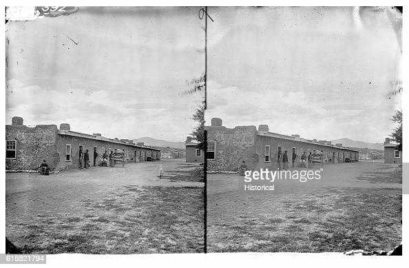 Troops loading a wagon from a warehouse in Fort Garland Fort Garland Colorado ca 1874 | Location Fort Garland Colorado USA