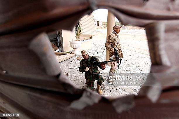 Troops loyal to Khalifa Haftar a retired general and former chief of staff for Moamer Kadhafi pose for picture as they fight alongside the Libyan...